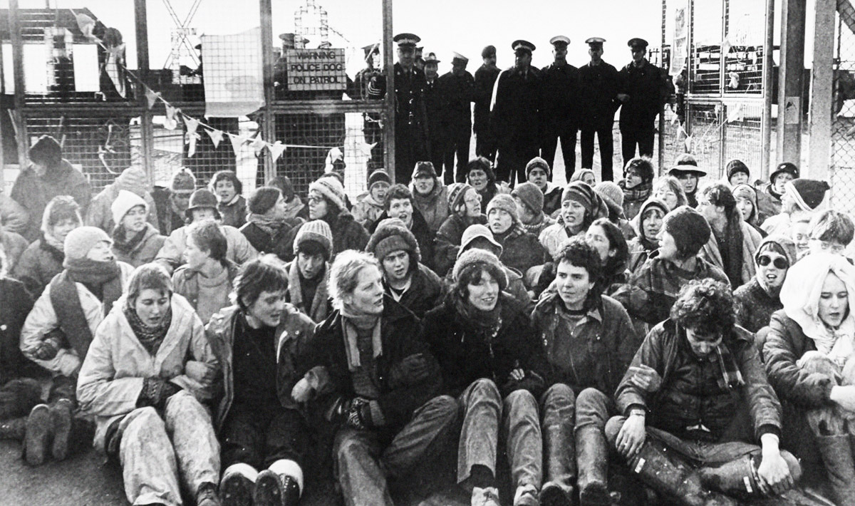 Greenham group sitting in front of police standing