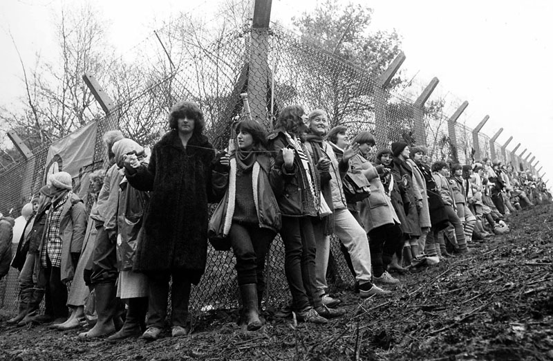 30,000 women joined hands around the base - Embrace the Base. Women protest at Greenham Common USAF American Airforce Base from which cruse missile launchers were deployed. 1982