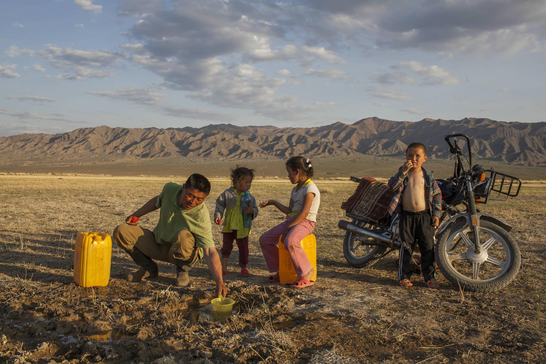 Nomads gathering water, Mongolia