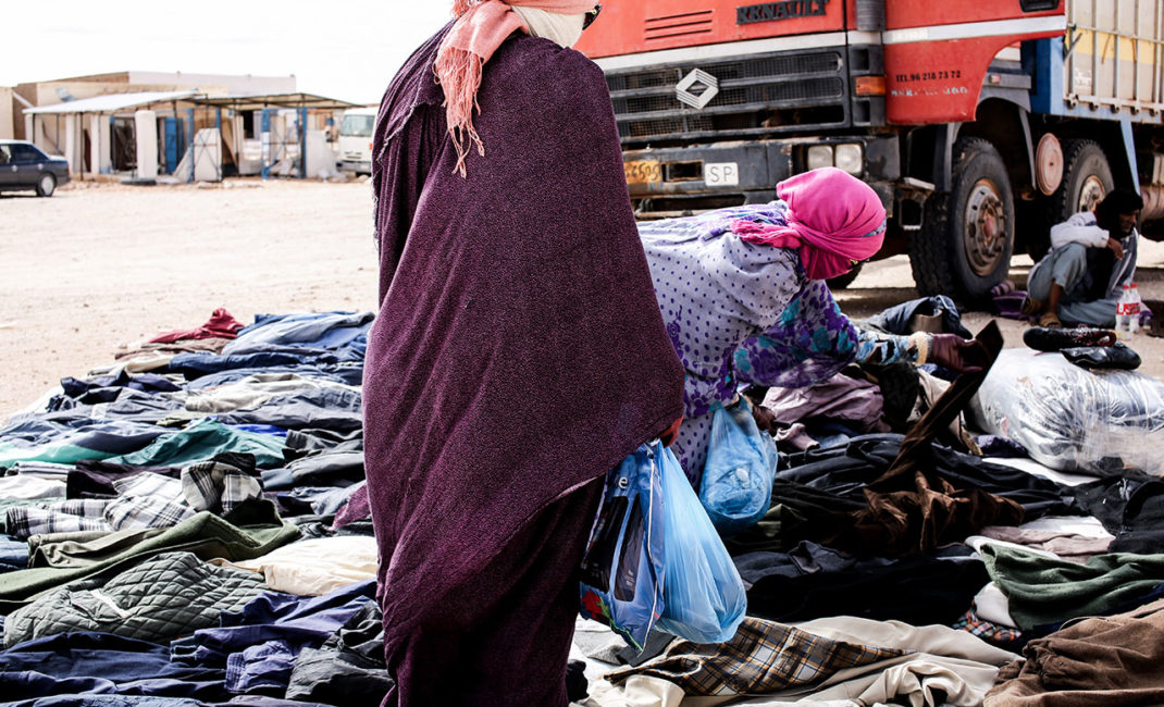 Two women in a street market in Smara refugee camp