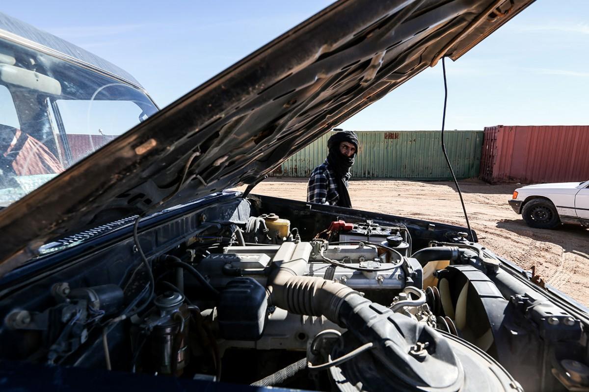A man near his broken car in Rabouni