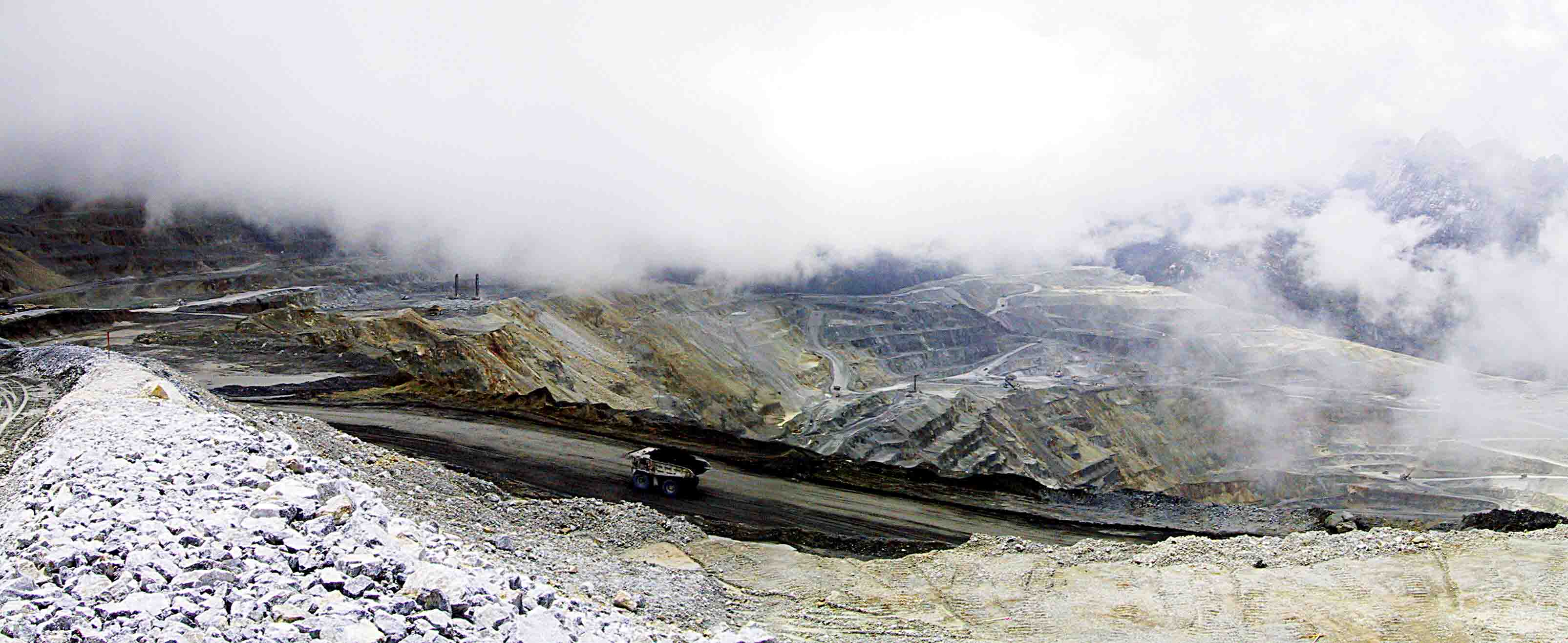 Misty opencut pit at Grasberg, Papua province, Indonesia. Photo by Michael Thirnbeck via Flickr