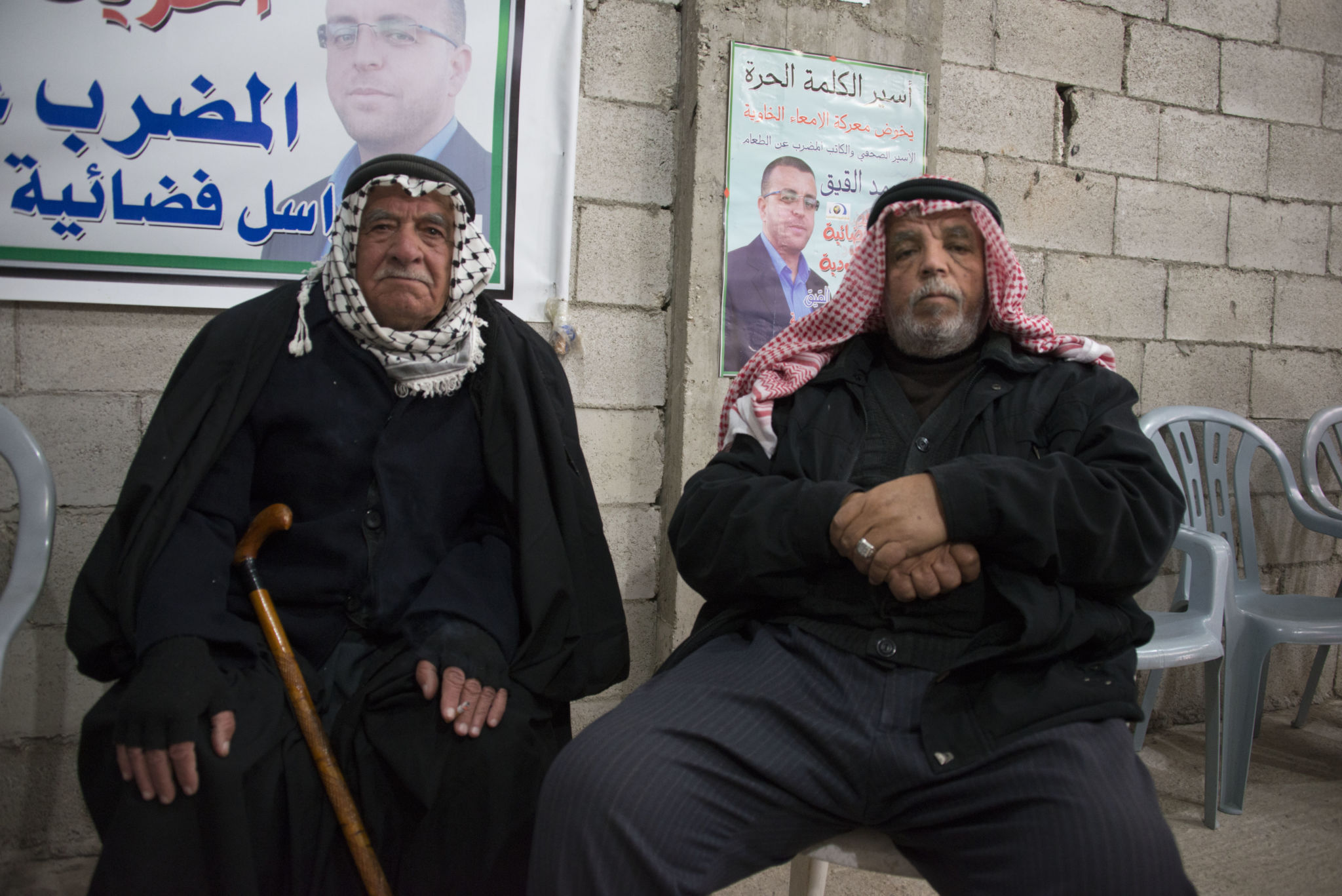 al-Qiq's father (right) and another relative. Photo by Jordan Siegel