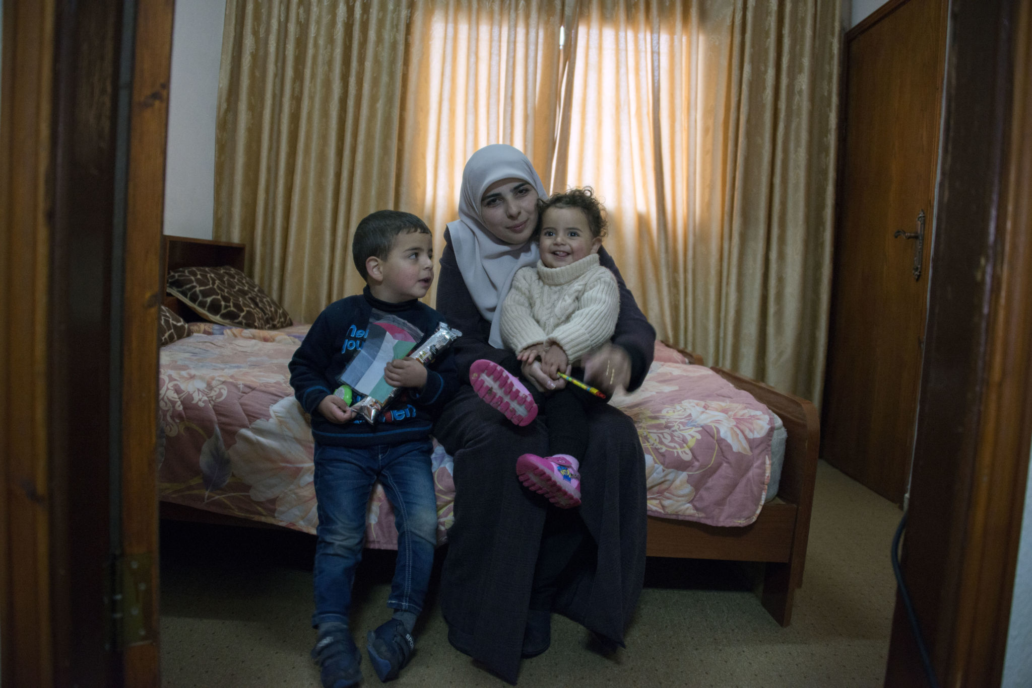 Al-Qiq's wife and children at home - Photo by Jordan Siegel