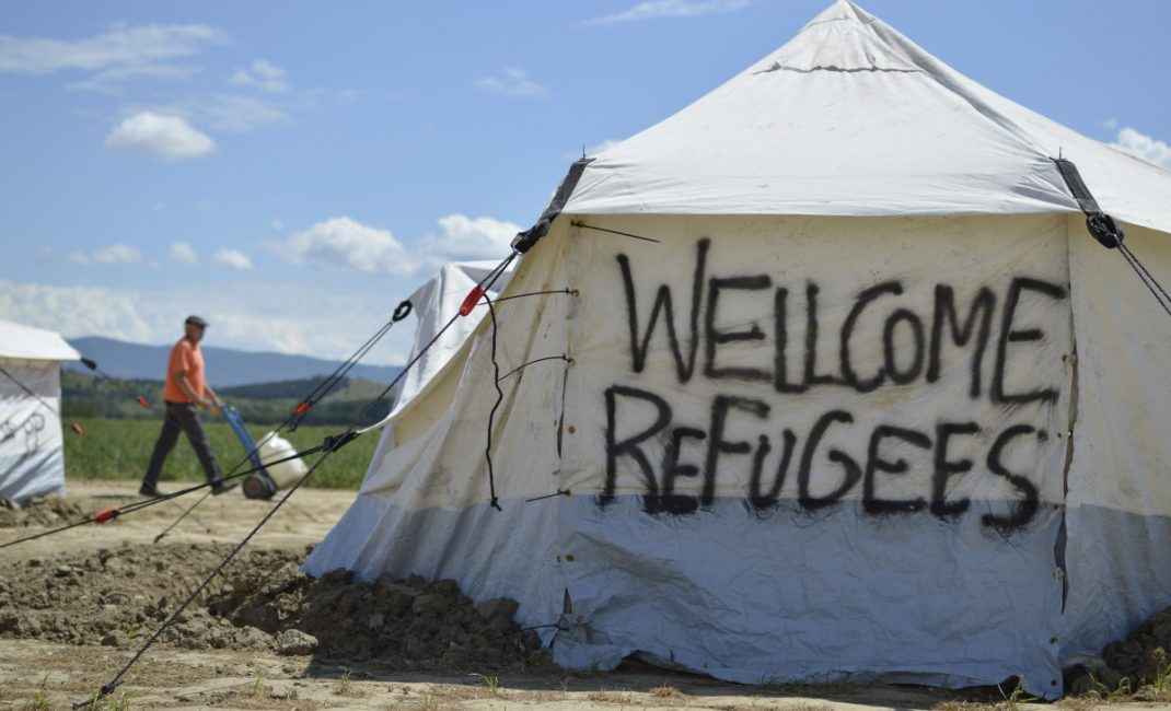"A tent with ""Welcome Refugees"" written on it"
