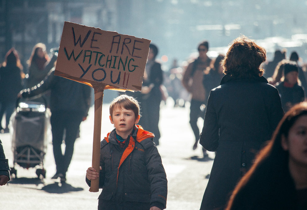 A young boy holds a placard at the Women's March in New York