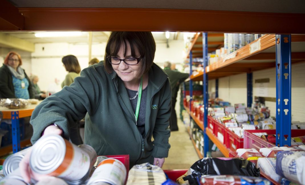A food bank volunteer in the warehouse - image by the Trussell Trust