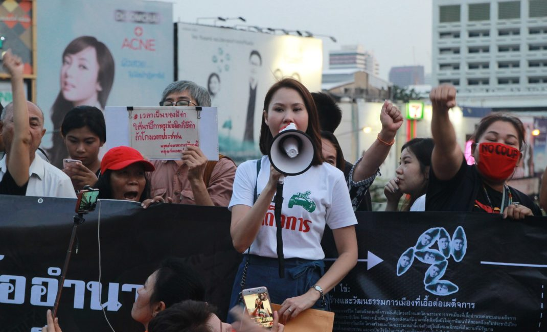 Bow speaks into a loud hailer during a protest in Thailand.