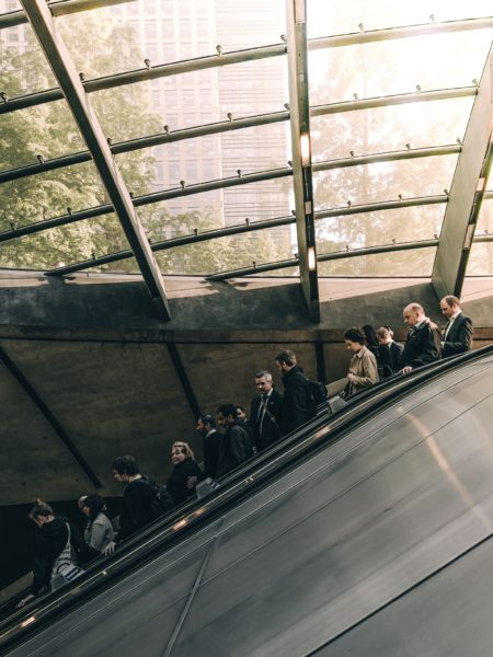 Office workers leave work at 5pm on an escalator
