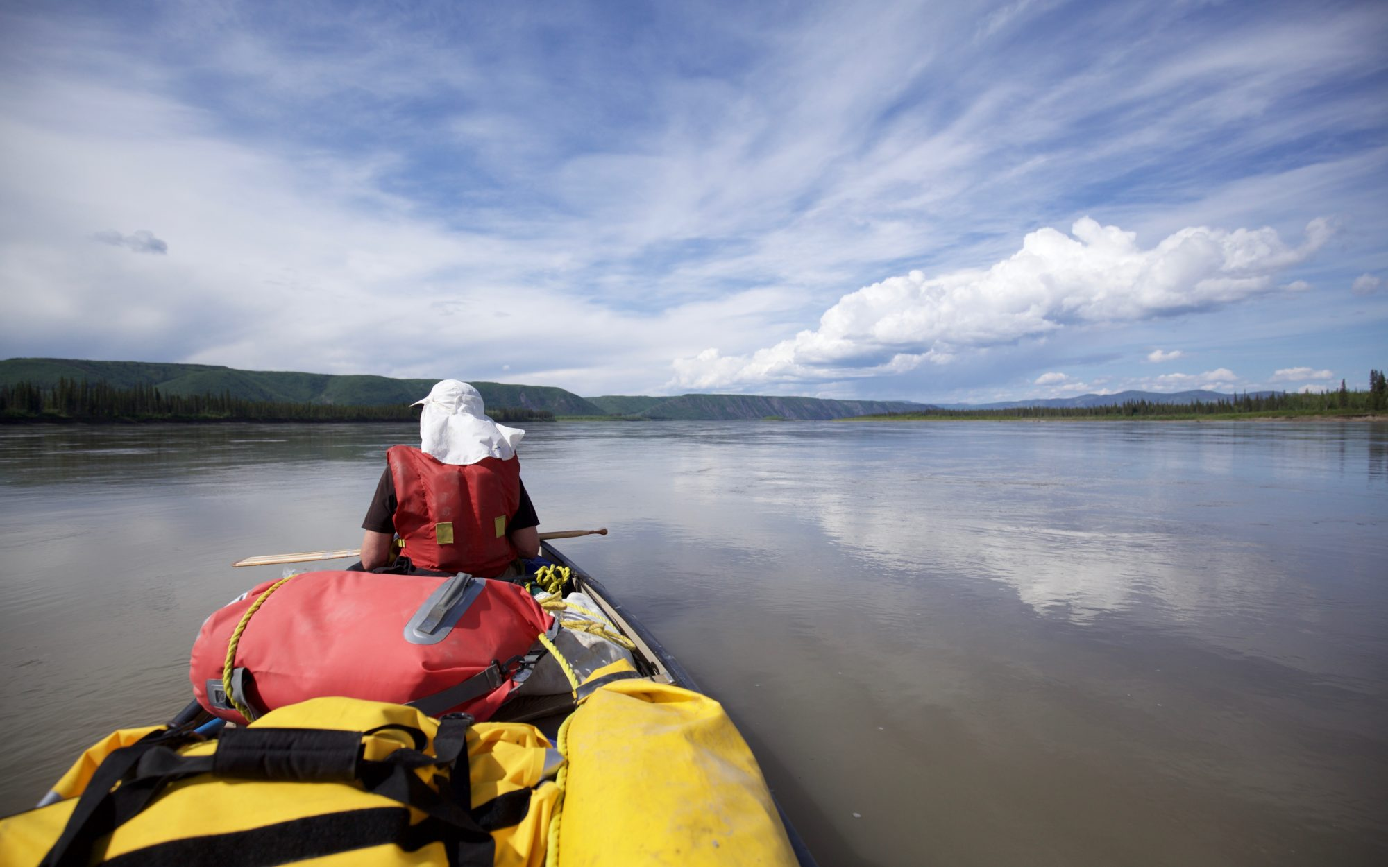 Adam Weymouth canoeing along the Yukon River