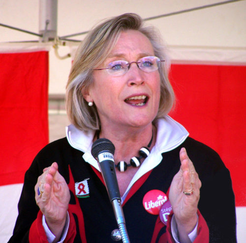 Minister of Crown-Indigenous Relations, Carolyn Bennet, speaks into a microphone on a podium