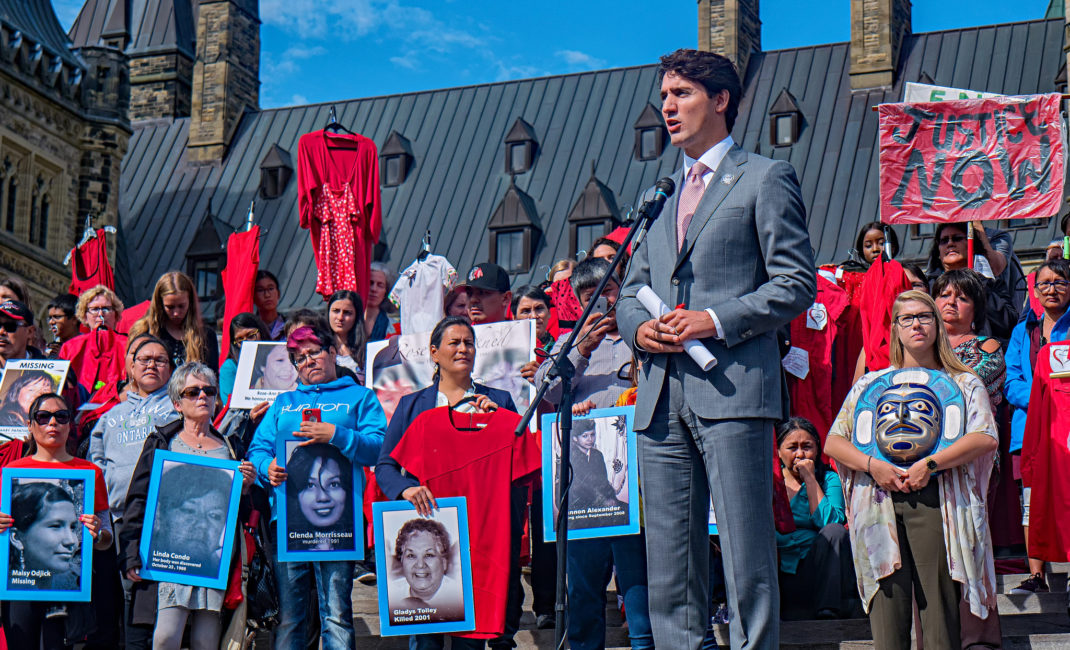 "Justin Trudeau addresses a ""Sisters in Spirit"" vigil for Missing and Murdered Indigenous Women and Girls in 2017"