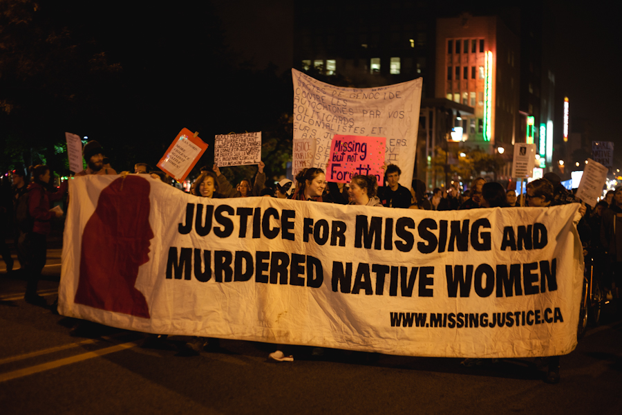 "Protesters at the Sisters in Spirit Memorial March carry a giant banner reading: ""Justice for Missing and Murdered Native Women"""