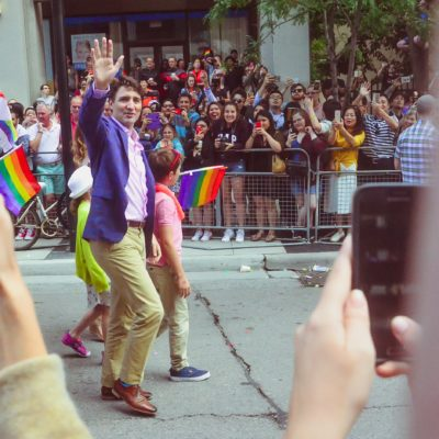 Canadian Prime Minister Justin Trudeau waves at Toronto parade