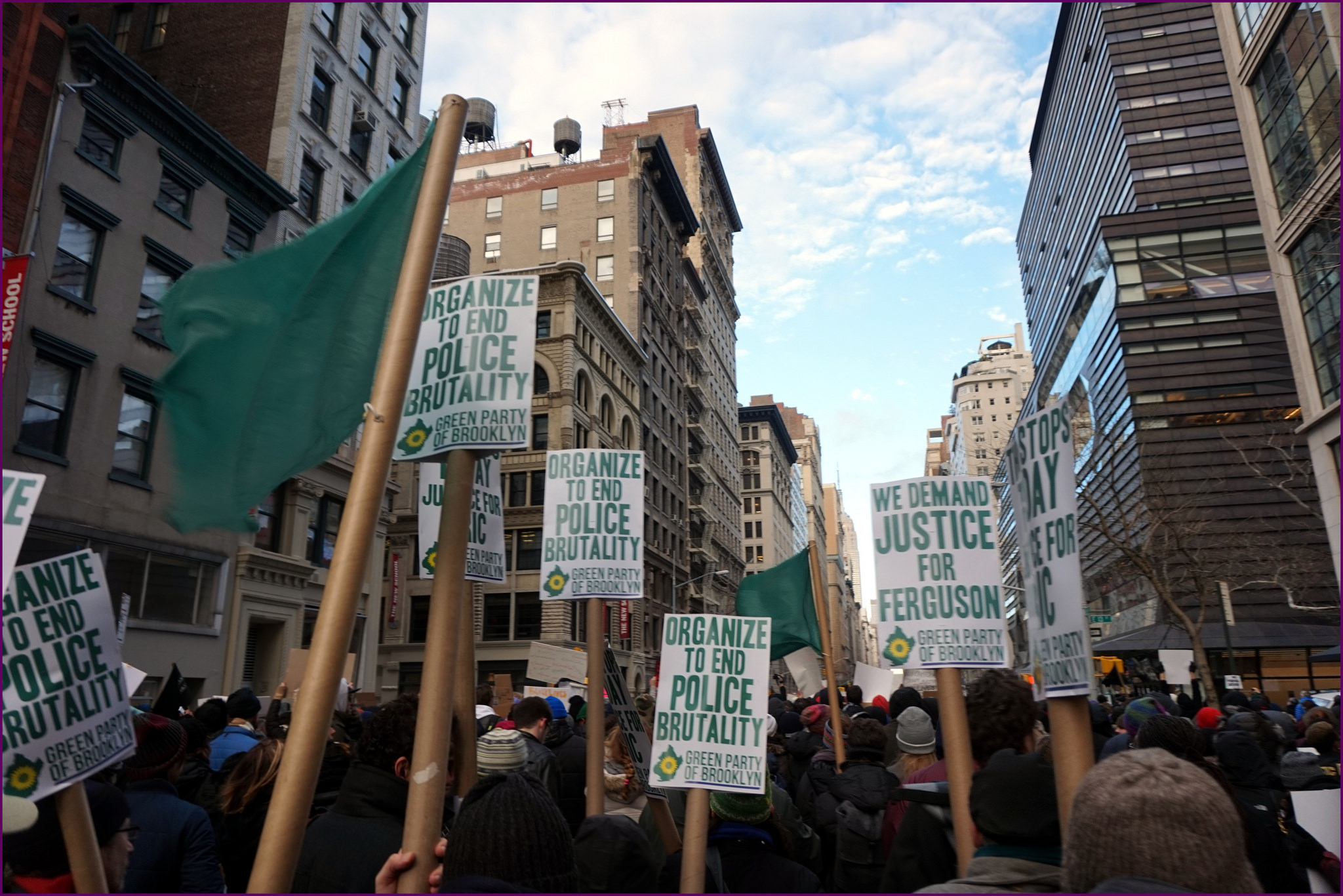 Placards above the crowd at a march in New York against police brutality