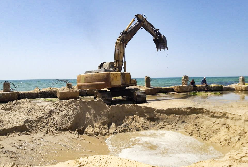 Using a digger, Amjad Tantish created a seawater pool to teach young swimmers.