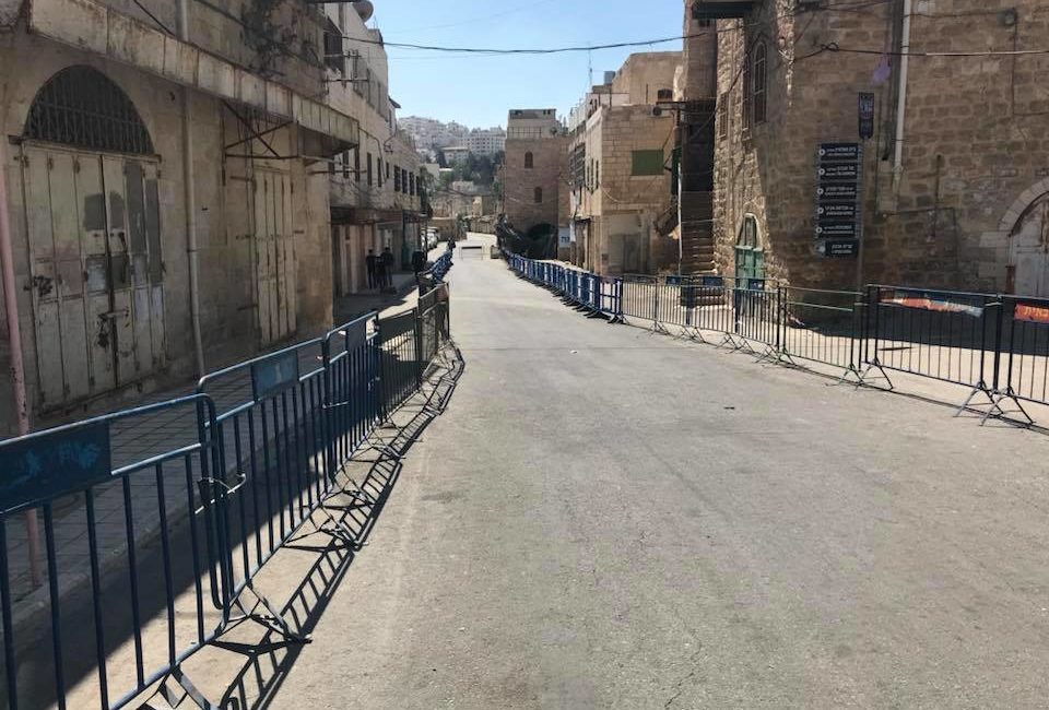 Hebron's Al-Shuhada Street has been a ghost town since the 1994 massacre - by Youth Against Settlements.