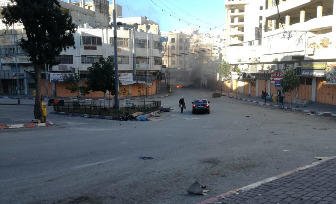 A street in downtown Hebron after violence - by Youth Against Settlements.