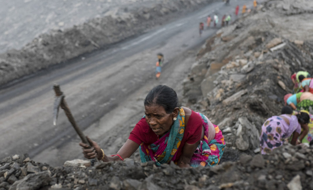 A woman illegally digs for coal in Jharia