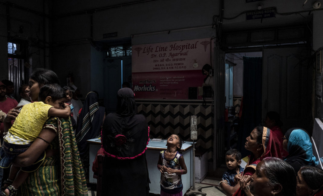 Patients in the waiting room of Life Line Hospital, Jharia