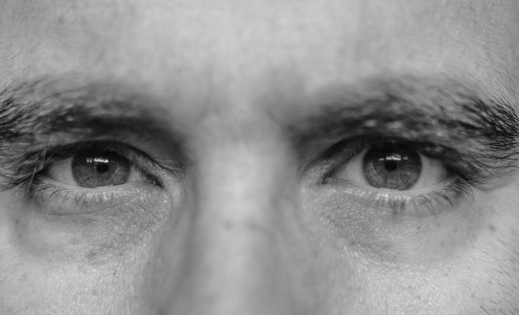 Closely focused in on a man's eyes, by Francesca Ungaro