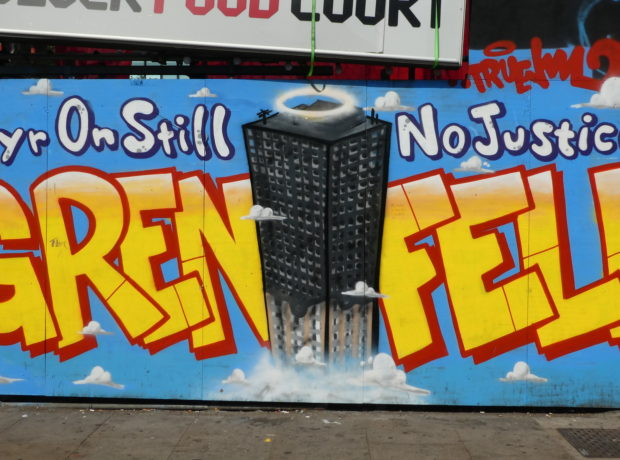 """Graffiti reads """"Grenfell - One year on still no justice?!"""""""