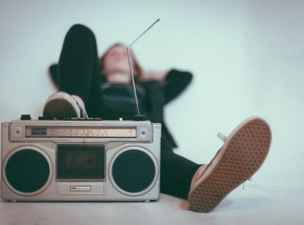 Radio in foreground; listener reclined in background