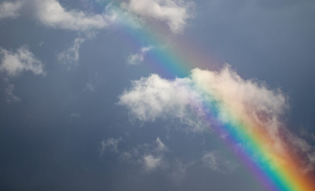 Rainbow over clouds.