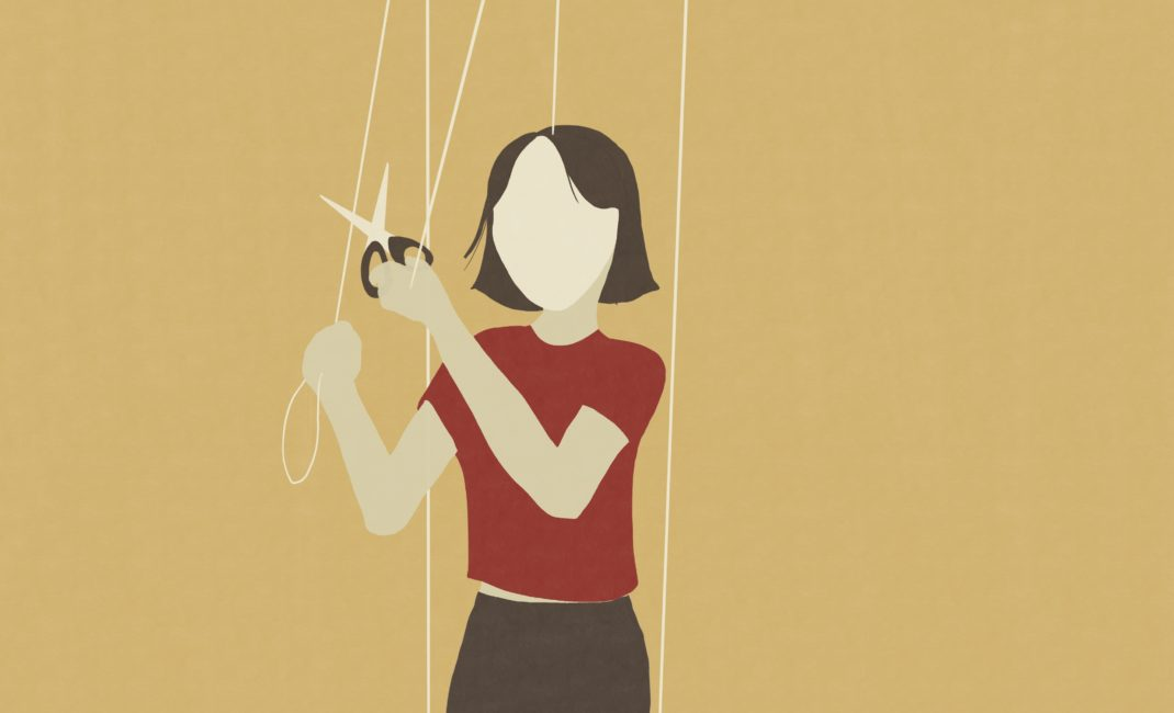 Artwork of faceless woman cutting puppet's strings