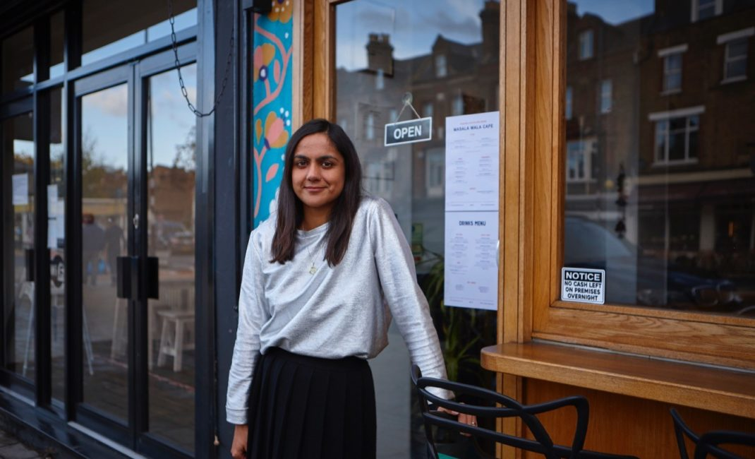 Saima Thompson stands outside her restaurant Masala Wala Cafe