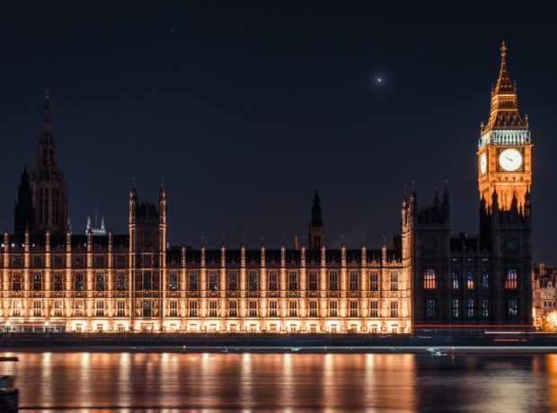 Houses of Parliament lit up at night - Photo by Samuel Zeller on Unsplash