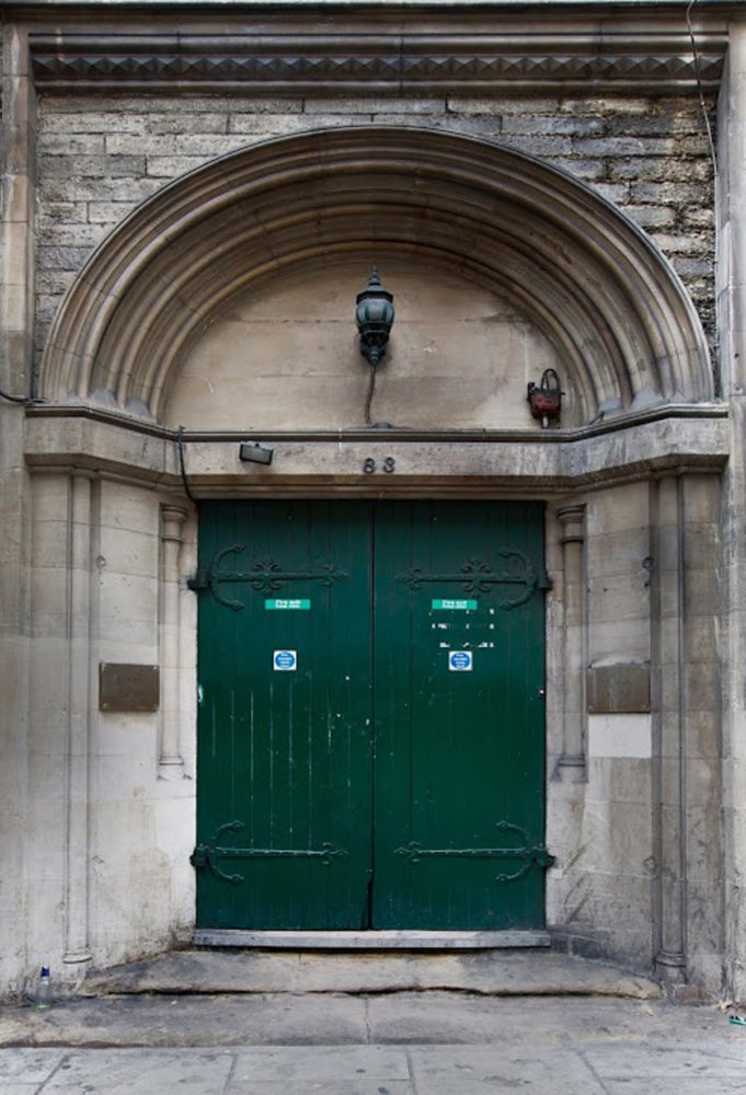 Photograph of a green door in an archway
