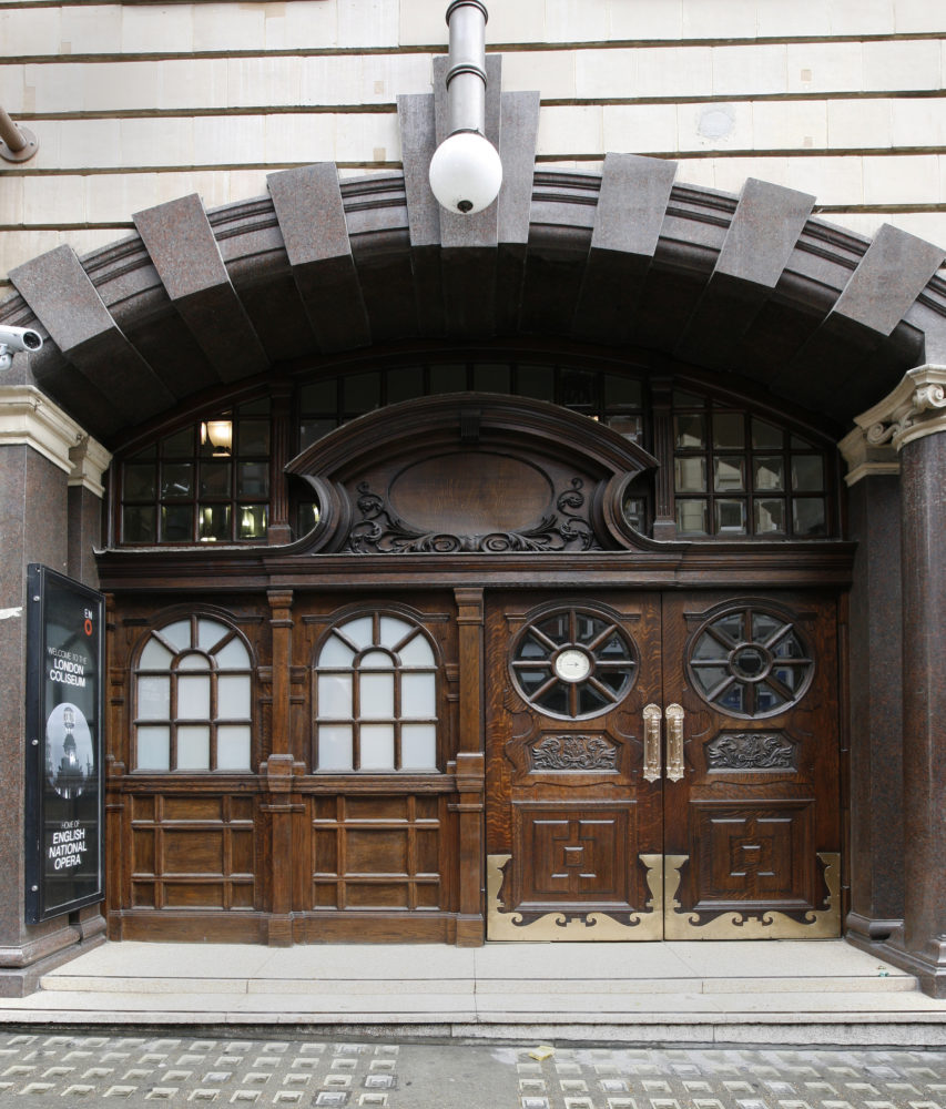 An ornate wooden doorway to an opera house