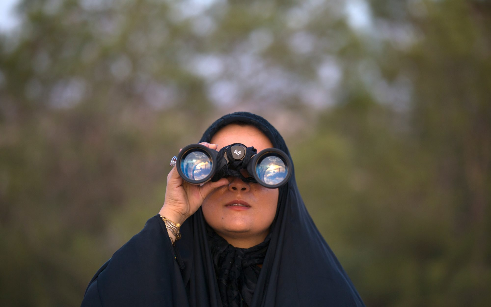 International womens day: Hijabi woman with binoculars