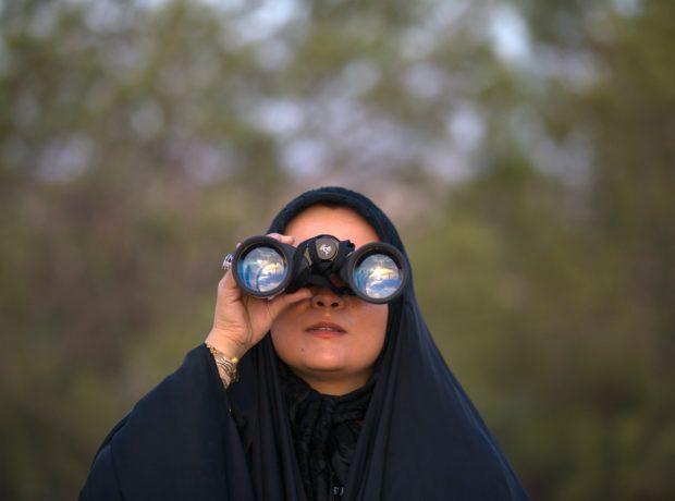 International womens day: Hijabi woman with binoculars