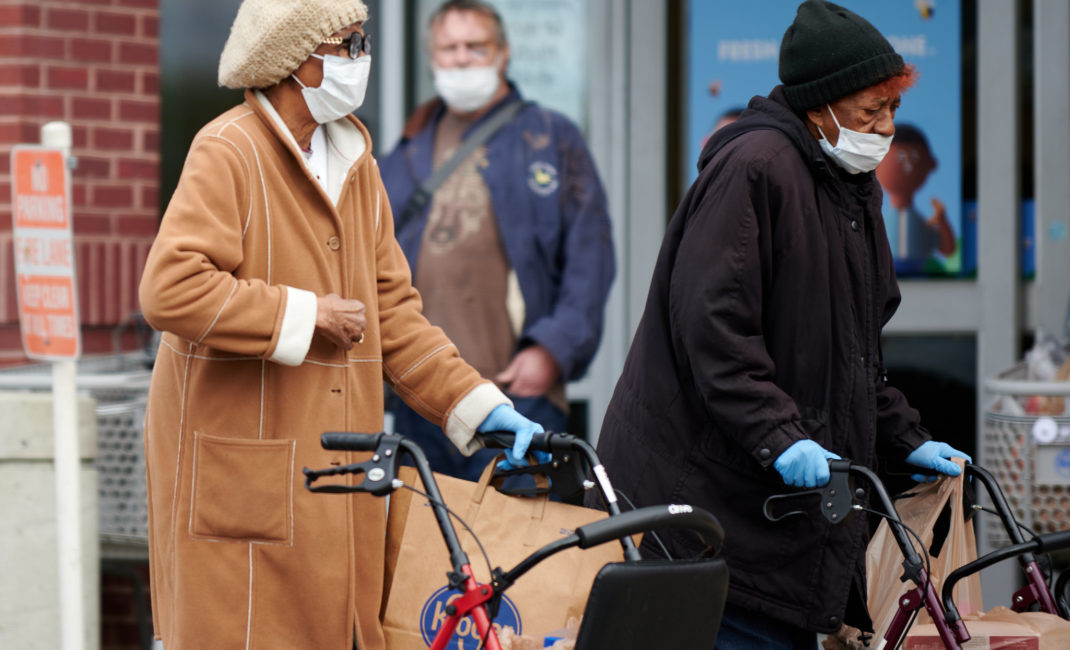 Two older African American women wear face masks as they go grocery shopping during the Covid pandemic in Virginia