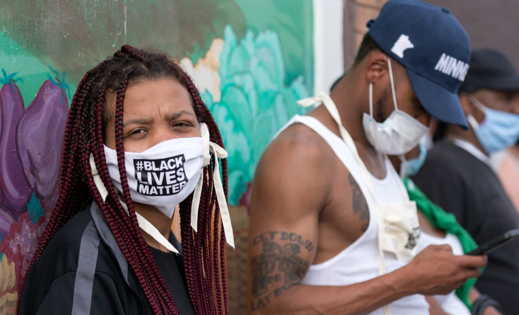 Protesters wear Black Lives Matter face masks at 38th Street and S. Chicago Avenue in Minneapolis on Tuesday after the death of George Floyd in Minneapolis, Minnesota