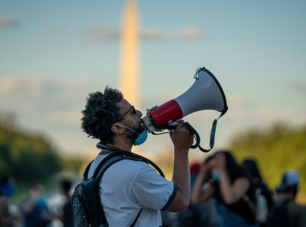 A protester with a loud hailer at the George Floyd Black Lives Matter protest at the Lincoln Memorial