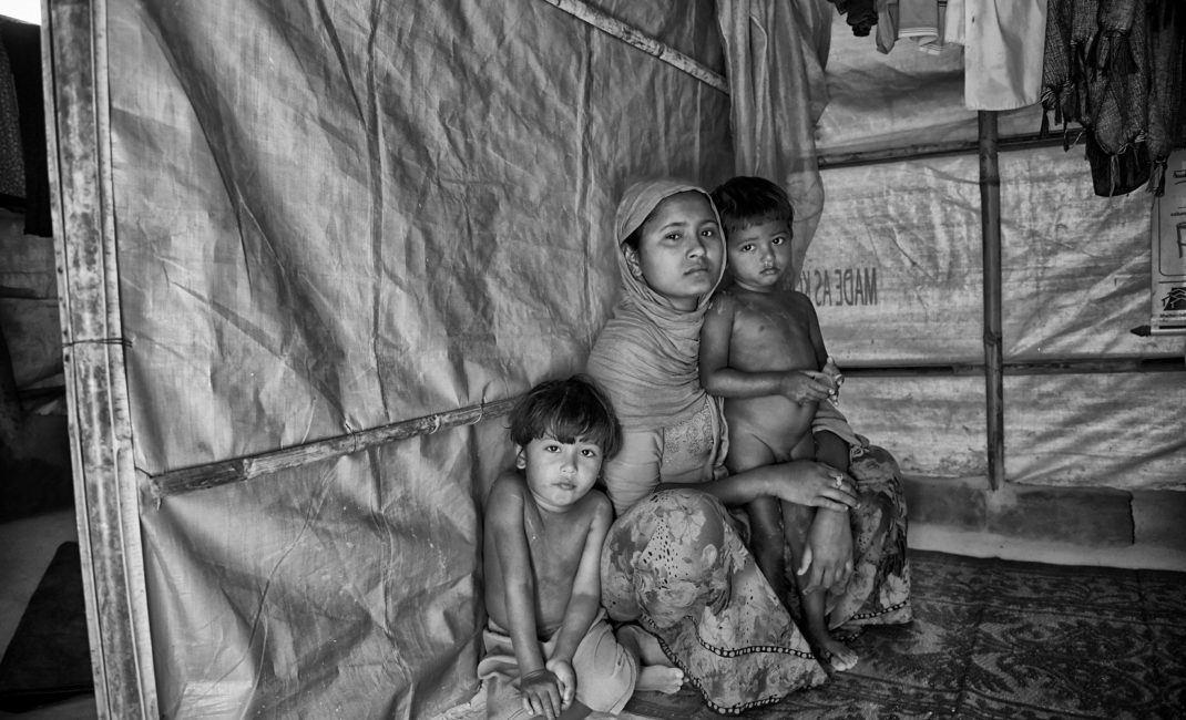 Farjina with her two sons, in their makeshift hut in the Balukhali Refugee Camp by Francesc Galban