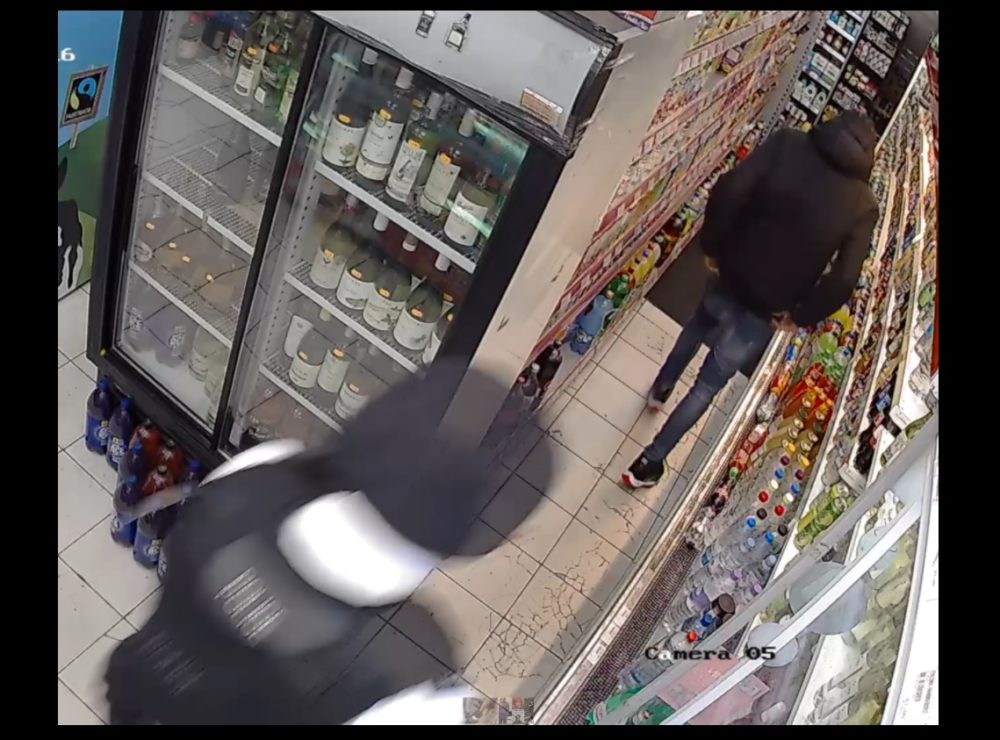 CCTV picture shows police officer pursuing Rashan Charles in London supermarket